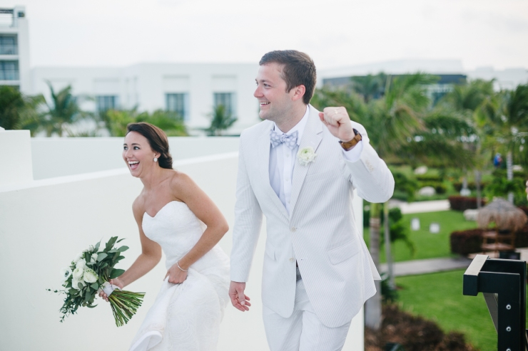 Newlyweds arrive to their reception at the resorts rooftop to celebrate