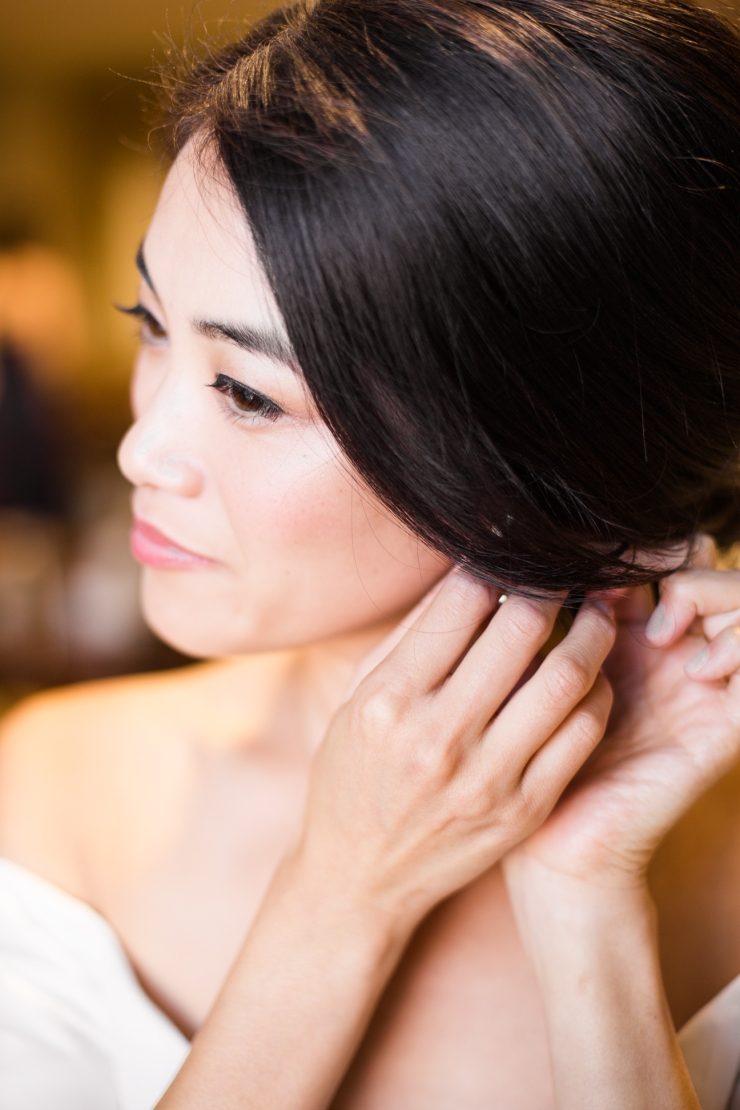 bride puts on her earrings on her wedding day, memphis tn wedding
