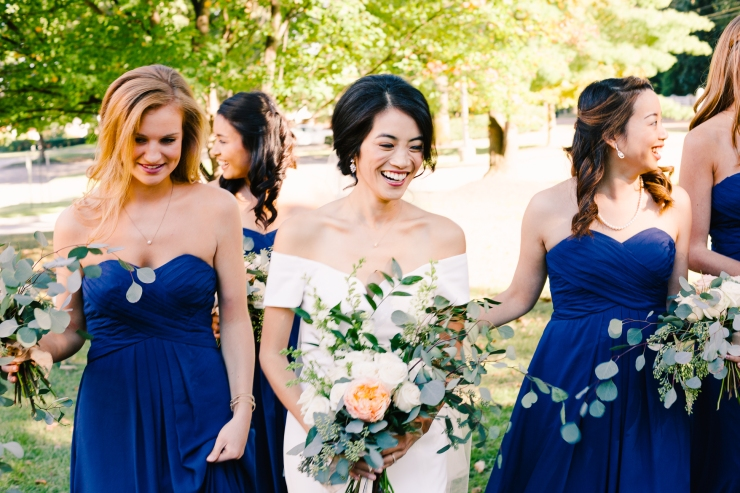 bride laughs with her bridesmaids on her wedding day, memphis tn wedding