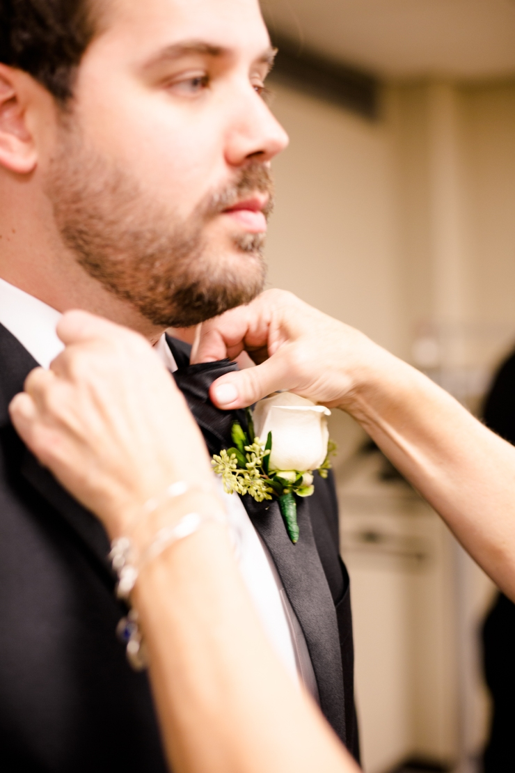 Groom's mom ties his bowtie, memphis tn wedding