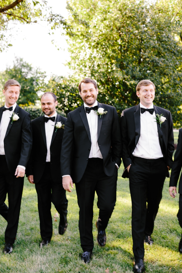 Groom and groomsmen walking together, memphis tn wedding