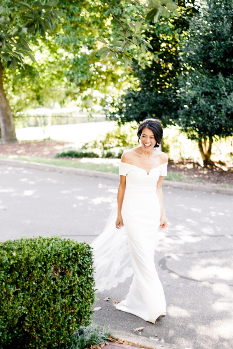 Bride smiles as she sees her groom during their first look, memphis tn wedding