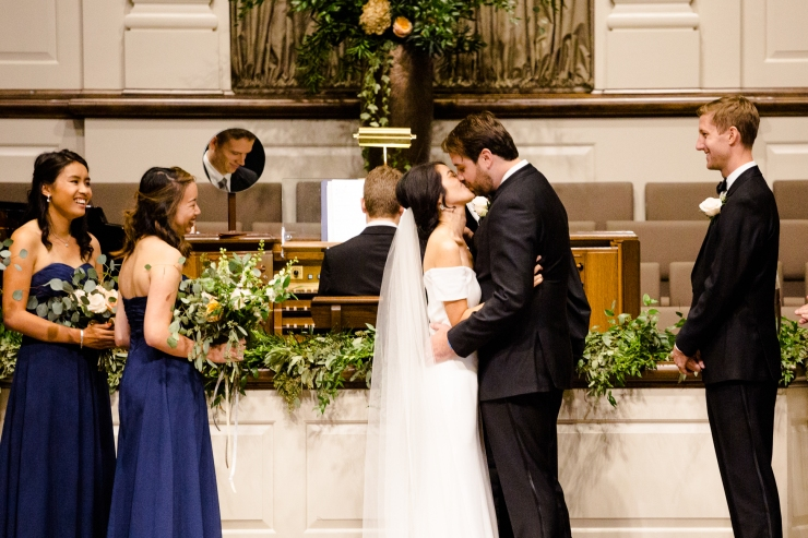 Bride and groom's first kiss during their wedding ceremony, memphis TN wedding