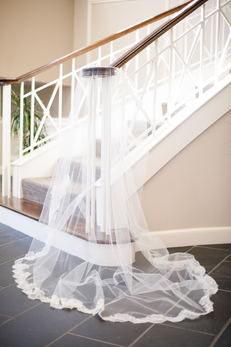 bride's veil draped over church stairs, detail shots