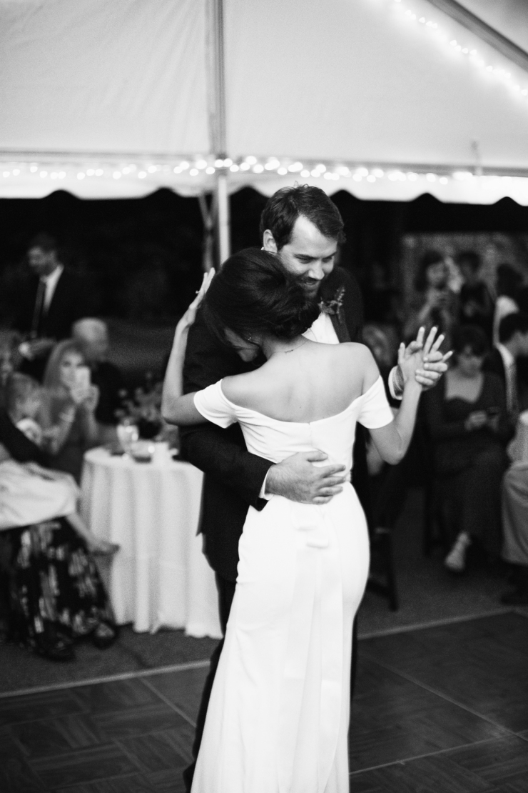 black and white portrait of bride and groom's first dance at tented reception, memphis TN wedding