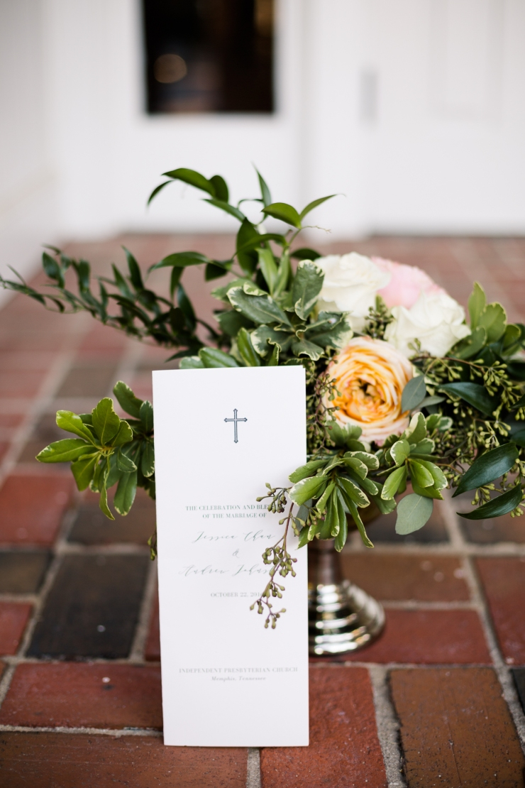 Ceremony program with flower arrangement, detail shot