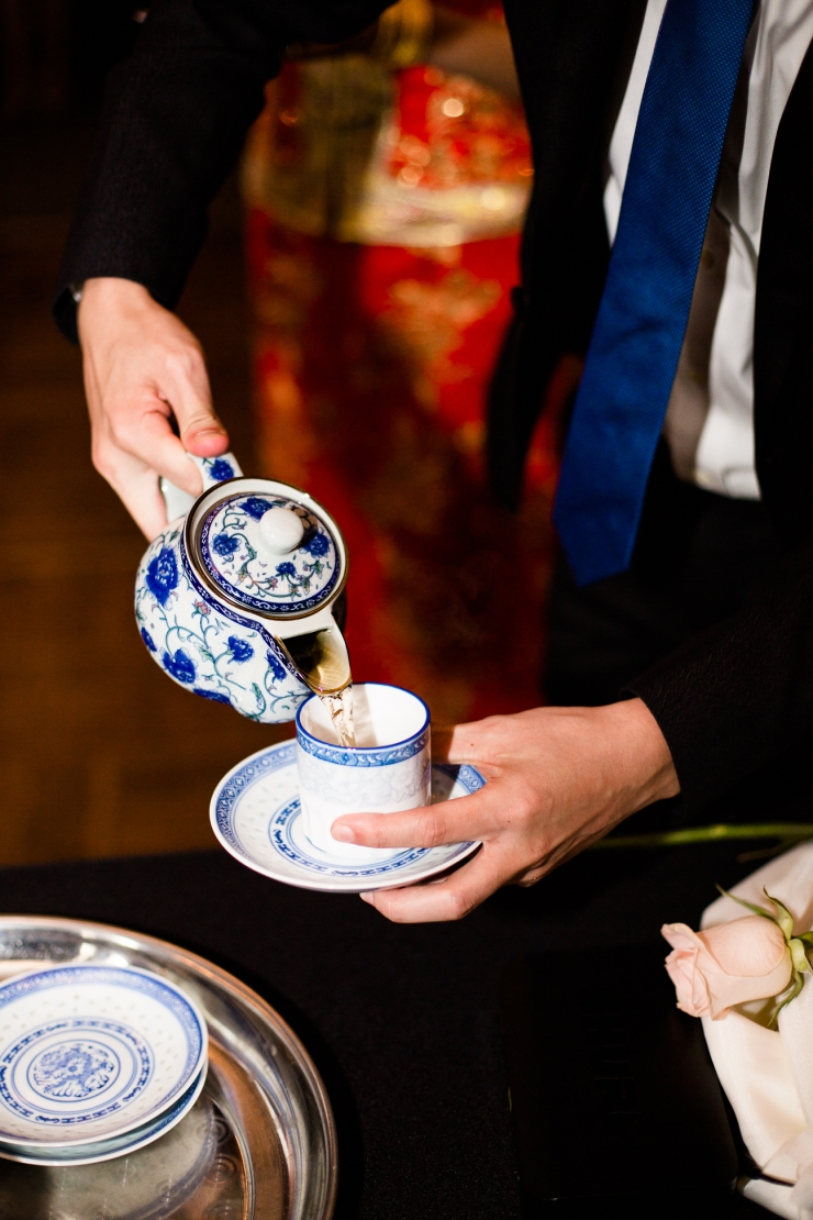 Pouring tea for Chinese tea ceremony at reception, memphis TN wedding