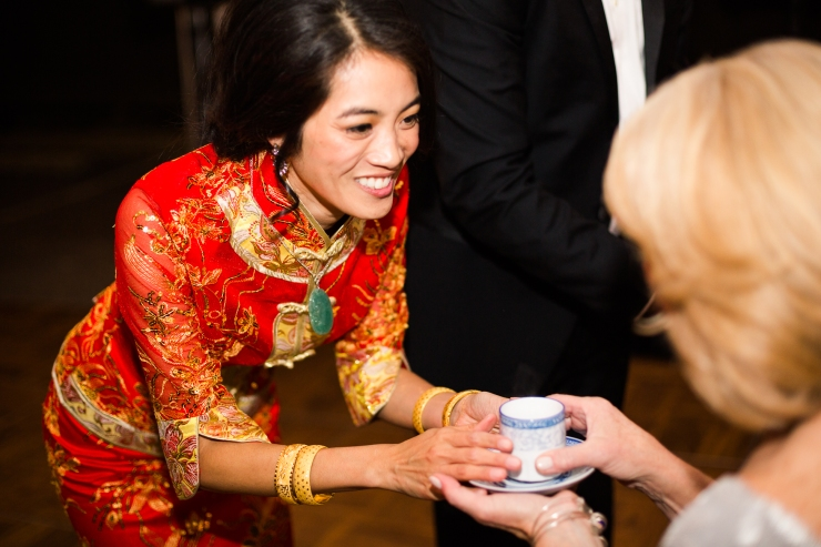 Bride offers mother in law tea during a Chinese tea ceremony at reception, memphis TN wedding